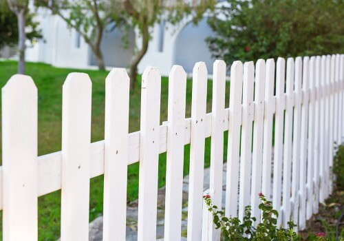 This photo shows a new wood fence in Nashua, NH painted white